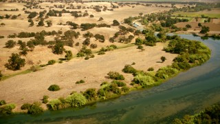 TS01_267 - 1080 stock footage aerial video fly over river and brown hills in Capay, California