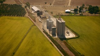 TS01_276 - 1080 stock footage aerial video of a grain elevator on a farm in Pleasant Grove, California