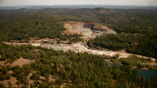 TS01_280 - 1080 stock footage aerial video of approaching a quarry in Meadow Vista, California