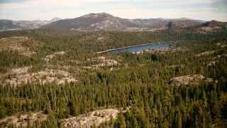 TS01_291 - 1080 stock footage aerial video of approaching Lake Valley Reservoir in the Sierra Nevada Mountains, California