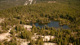 TS01_297 - 1080 stock footage aerial video of Kidd Lake, surrounded by evergreens, in the Sierra Nevada Mountains, California