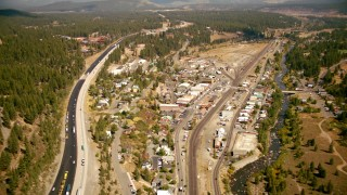 TS01_304 - 1080 stock footage aerial video of flying by Interstate 80 and the town of Truckee, California