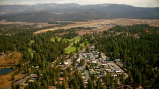 TS01_305 - 1080 stock footage aerial video of flying over mobile homes and golf course toward the airfield in Truckee, California