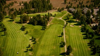 TS01_306 - 1080 stock footage aerial video of flying over Ponderosa Golf Course, revealing highway, Truckee, California