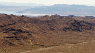 TS02_13 - 1080 stock footage aerial video flyby the Muddy Mountains with a view of Lake Mead, Valley of Fire, Nevada