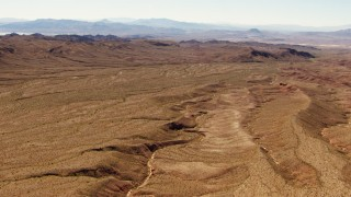 TS02_14 - 1080 stock footage aerial video flying over desert valley toward mountains in the Valley of Fire, Nevada