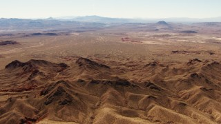 TS02_17 - 1080 stock footage aerial video of flying over Muddy Mountains toward Frenchman Range, Valley of Fire, Nevada