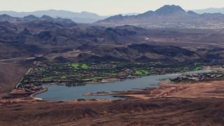 TS02_25 - 1080 stock footage aerial video of homes on the shore of Lake Las Vegas in Henderson, Nevada