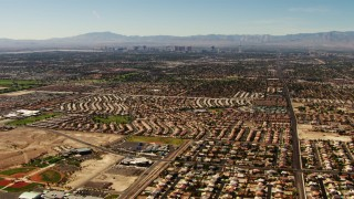 TS02_31 - 1080 stock footage aerial video pan across homes in East Las Vegas to reveal the Las Vegas Strip, Nevada
