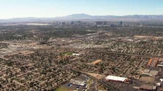 TS02_35 - 1080 stock footage aerial video fly over East Las Vegas homes toward the Las Vegas Strip, Nevada