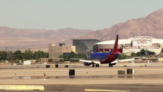 TS02_47 - 1080 stock footage aerial video of tracking a Southwest passenger jet at McCarran International Airport, Las Vegas, Nevada