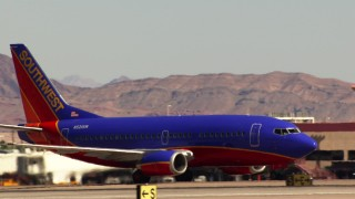 TS02_49 - 1080 stock footage aerial video of Southwest jet at McCarran International Airport, Nevada
