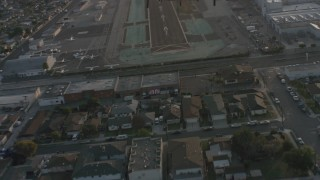 WA001_001 - 4K stock footage aerial video of Lear Jet landing gear while taking off from Hawthorne Municipal Airport, California
