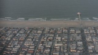 WA001_002 - 4K stock footage aerial video fly over homes, Manhattan Beach Pier, and the Pacific Ocean, California