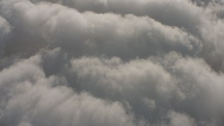 WA001_004 - 4K stock footage aerial video of a bird's eye view of clouds, with the Pacific Ocean visible through breaks, Southern California