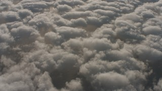 WA001_005 - 4K stock footage aerial video of a reverse view of the Pacific Ocean visible through breaks in the cloud cover, Southern California