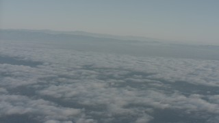 WA001_013 - Aerial stock footage of Pan across clouds and mountain ridges in Ventura County, California