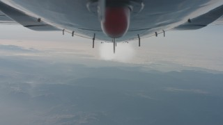 WA001_026 - 4K stock footage aerial video of a view of the contrail from beneath the jet over the Los Padres National Forest, California