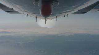 WA001_027 - 4K stock footage aerial video of a reverse view of the bottom of the plane and the contrail over Los Padres National Forest, California