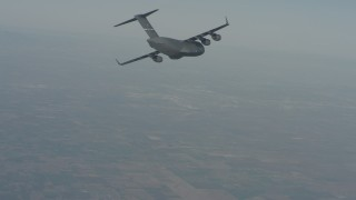 WA001_033 - 4K stock footage aerial video of a Boeing C-17 in flight over Solano County, California