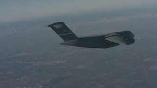 WA001_038 - 4K stock footage aerial video track a Boeing C-17 before it ascends over Solano County, California