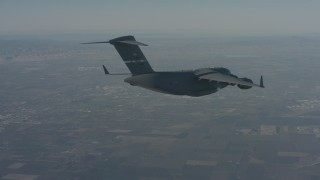 WA001_041 - 4K stock footage aerial video track a Boeing C-17 as it flies ahead over Solano County, California