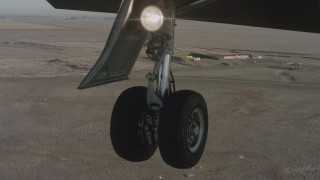 WA001_056 - 4K stock footage aerial video of a view of the Lear jet landing gear as it lands at Travis Air Force Base, California
