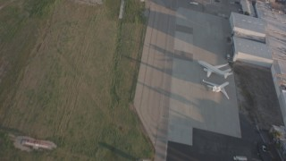 WA002_001 - Aerial stock footage of View of the runway as a Lear jet takes off from Van Nuys Airport, California