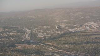WA002_002 - 4K stock footage aerial video pan across hillside homes and suburban neighborhoods in Woodland Hills, California