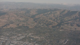 WA002_004 - 4K stock footage aerial video fly over suburban homes to approach Highway 118 and the mountains, Chatsworth, California