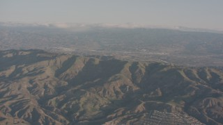 WA002_005 - 4K stock footage aerial video of approaching a ridge in the Santa Susana Mountains, California