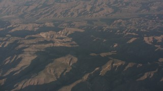 WA002_006 - 4K stock footage aerial video fly over the Santa Susana Mountains to approach farms in Piru, California