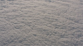 WA002_029 - Aerial stock footage of Tilt from the edge of the clouds to thick cloud cover over the Central Valley, California