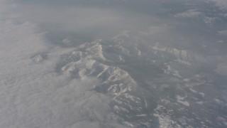WA002_075 - 4K stock footage aerial video of Sierra Nevada Mountains below misty clouds, California