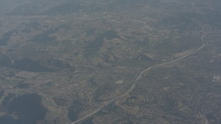 WA003_005 - 4K stock footage aerial video of freeway and suburban homes in Simi Valley, California