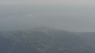 WA003_009 - Aerial stock footage of A view of the Pacific Ocean and Malibu from the Santa Monica Mountains, California