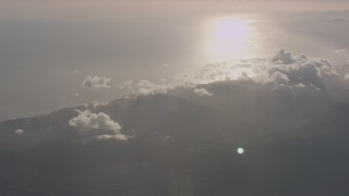 WA003_011 - 4K stock footage aerial video of the Santa Monica Mountains on the coast and sun reflection on the Pacific Ocean, California