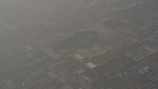 WA003_022 - 4K stock footage aerial video of a reverse view of race tracks in Inglewood, California