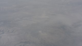 WA004_005 - 4K stock footage aerial video fly over misty clouds and snow mountains in Lassen County, California