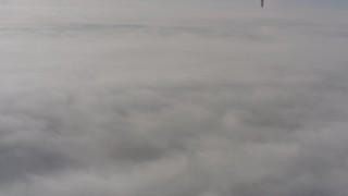 WA004_006 - 4K stock footage aerial video of a dense cover of clouds over Lassen County, California