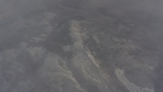 WA004_008 - 4K stock footage aerial video bird's eye view of snowy mountain ridge and misty clouds in Lassen County, California