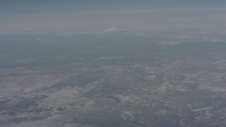 WA004_009 - 4K stock footage aerial video tilt from snowy mountains to reveal Mount Shasta, Modoc County, California