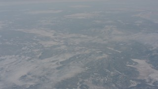 WA004_012 - 4K stock footage aerial video fly over snowy mountains in Modoc County, California
