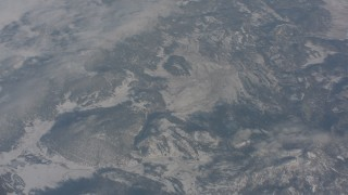 WA004_013 - 4K stock footage aerial video of a bird's eye view of snowy mountains in Modoc County, California