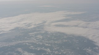 WA004_015 - 4K stock footage aerial video of a reverse view of clouds over snowy mountains in Modoc County, California