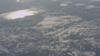 WA004_020 - 4K stock footage aerial video tilt from snowy hills to reveal lakes in Lake County, Oregon