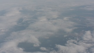 WA004_026 - 4K stock footage aerial video tilt from dense cover of clouds over Lake County, Oregon