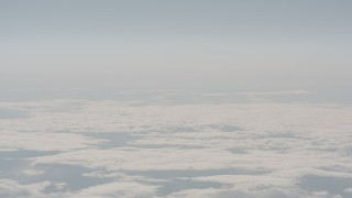 WA004_027 - 4K stock footage aerial video track a jet airplane flying over cloud cover in Lake County, Oregon