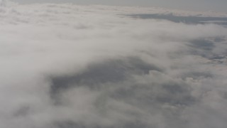 WA004_028 - 4K stock footage aerial video of reverse view of high altitude clouds over Lake County, Oregon