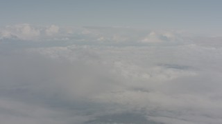 WA004_031 - 4K stock footage aerial video of flying through mist to reveal white cloud cover over Lake County, Oregon